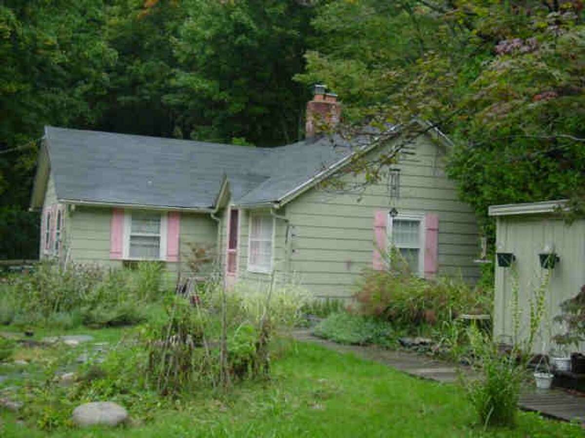 The house at 695 Danbury Road, as shown on the Wilton Assessor's database, suffered severe damage from fire on Aug. 4.