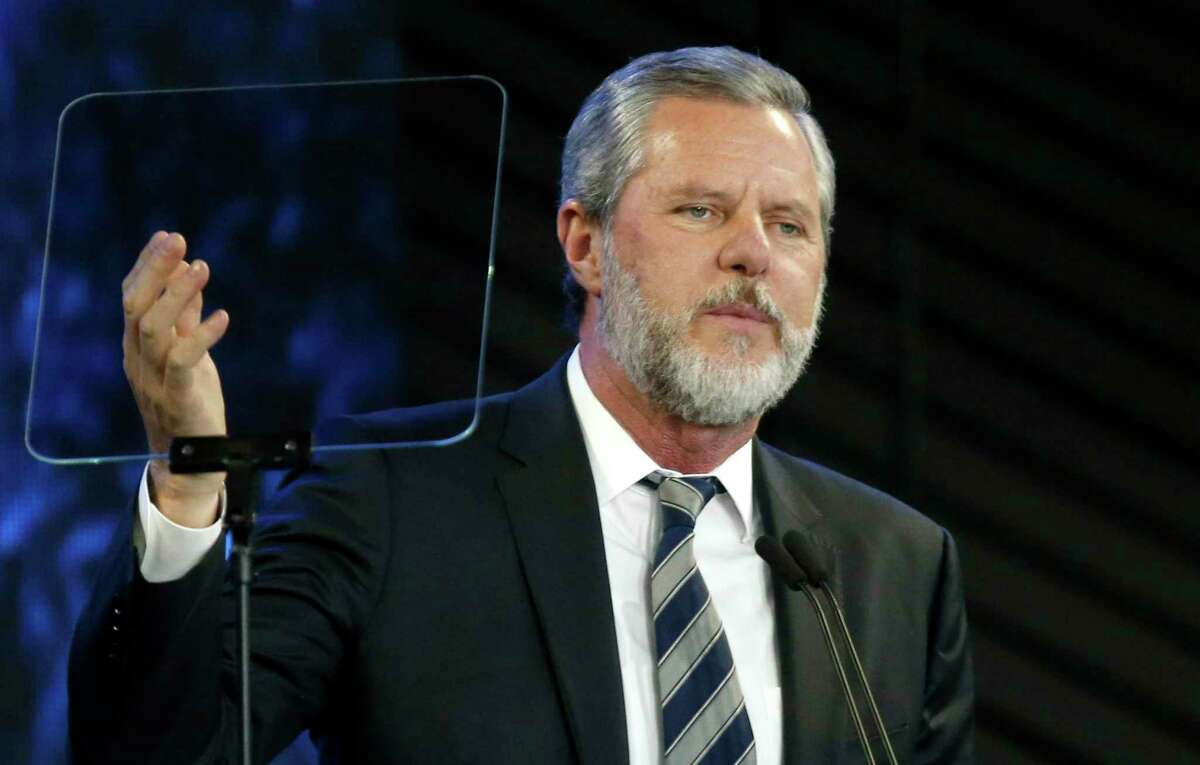 In this Nov. 28, 2018, file photo, Liberty University President Jerry Falwell Jr. speaks before a convocation at Liberty University in Lynchburg, Va. Nearly three dozen black alumni of Liberty University are denouncing school President Jerry Falwell Jr. on Monday, June 1, 2020, suggesting he step down after he mocked Virginia's mask-wearing requirement by invoking the blackface scandal that engulfed the state's governor last year.