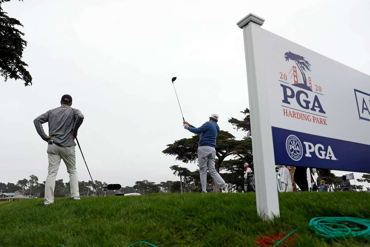 Davis Love III tees off as Steve Stricker watches on 18th hole during PGA Championship practice round at Harding Park in San Francisco, Calif., on Wednesday, August 5, 2020.