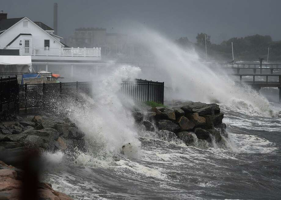 Waves break over the Black Rock Yacht Club as Tropical Storm Isaias kicks up the surf on Long Island Sound in Bridgeport on Tuesday. Photo: Brian A. Pounds / Hearst Connecticut Media / Connecticut Post