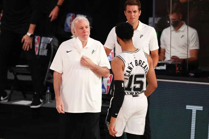 Head coach Gregg Popovich of the Spurs talks with Quinndary Weatherspoon (15) during action against the Denver Nuggets in the second half at Visa Athletic Center at ESPN Wide World Of Sports Complex on Aug. 5, 2020, in Lake Buena Vista, Fla.