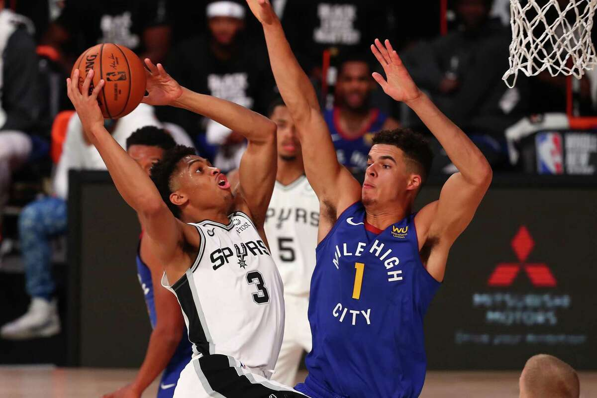 Keldon Johnson (3) of the shoots against Michael Porter Jr. of the Denver Nuggets during the second half at Visa Athletic Center at ESPN Wide World Of Sports Complex on Aug. 5, 2020, in Lake Buena Vista, Fla.