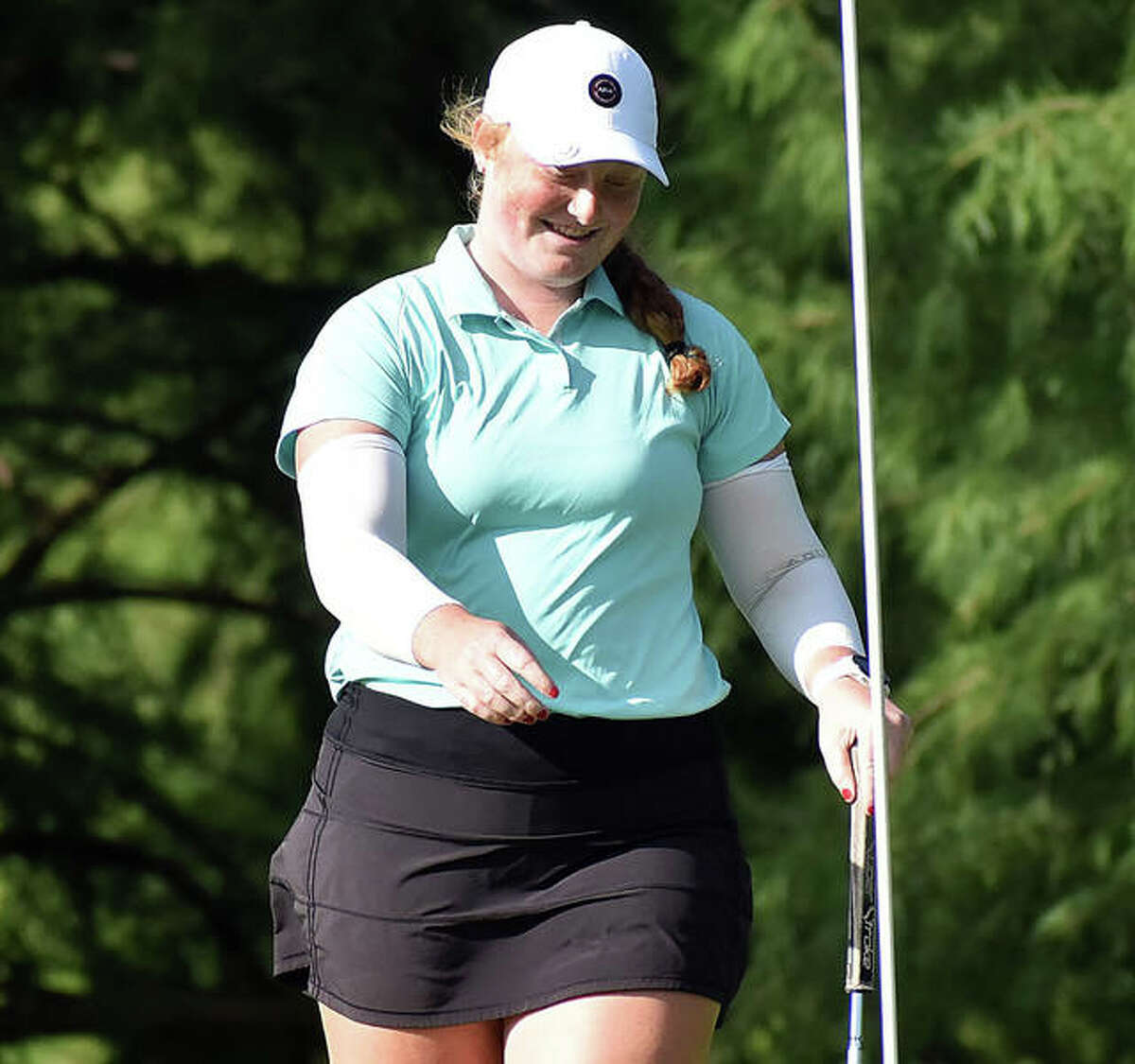 East Alton's Gracie Piar, a junior at Marquette Catholic, reacts after sinking a 20-foot putt for eagle on hole No. 11 in Monday's opening round at the 41st Illinois State Junior Girls Championship at Hickory Point Golf Course in Forsyth. Piar placed fifth with rounds of 71-74.