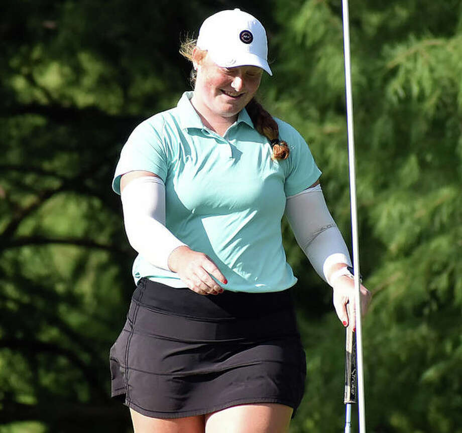 East Alton's Gracie Piar, a junior at Marquette Catholic, reacts after sinking a 20-foot putt for eagle on hole No. 11 in Monday's opening round at the 41st Illinois State Junior Girls Championship at Hickory Point Golf Course in Forsyth. Piar placed fifth with rounds of 71-74. Photo: Matt Kamp / Hearst Illinois