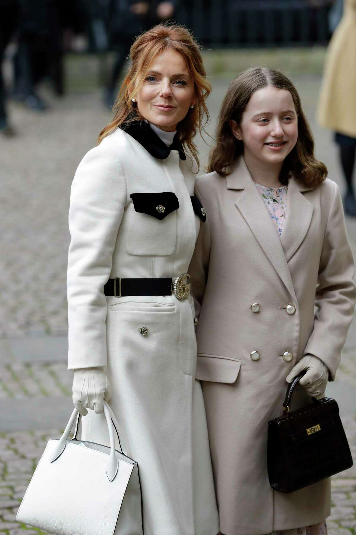 Singer Geri Halliwell, former member of girl group the Spice Girls, arrives with her daughter Bluebell Madonna Halliwell to attend the annual Commonwealth Day service at Westminster Abbey in London, Monday, March 9, 2020. The annual service, organised by the Royal Commonwealth Society, is the largest annual inter-faith gathering in the United Kingdom. (AP Photo/Kirsty Wigglesworth)