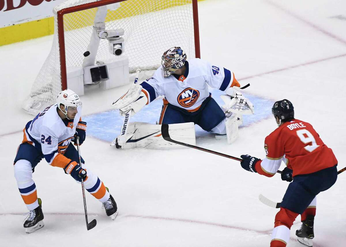 Florida Panthers centre Brian Boyle (9) scores past New York Islanders goaltender Semyon Varlamov (40) as defenceman Scott Mayfield (24) looks on during third period NHL Eastern Conference Stanley Cup playoff hockey action in Toronto on Wednesday, Aug. 5, 2020. (Nathan Denette/The Canadian Press via AP)