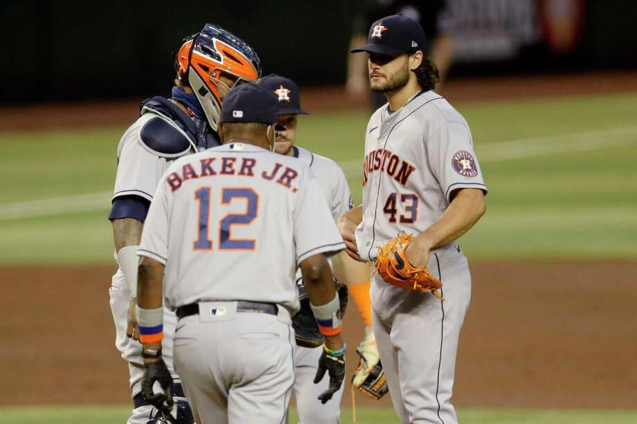 Houston Astros starting pitcher Lance McCullers Jr. (43) is pulled from the game by manager Dusty Baker JR. (12) during the fourth inning of a baseball game against the Arizona Diamondbacks Wednesday, Aug. 5, 2020, in Phoenix. (AP Photo/Matt York) Photo: Matt York, Associated Press / Copyright 2020 The Associated Press. All rights reserved