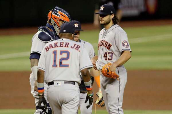 Houston Astros starting pitcher Lance McCullers Jr. (43) is pulled from the game by manager Dusty Baker JR. (12) during the fourth inning of a baseball game against the Arizona Diamondbacks Wednesday, Aug. 5, 2020, in Phoenix. (AP Photo/Matt York)