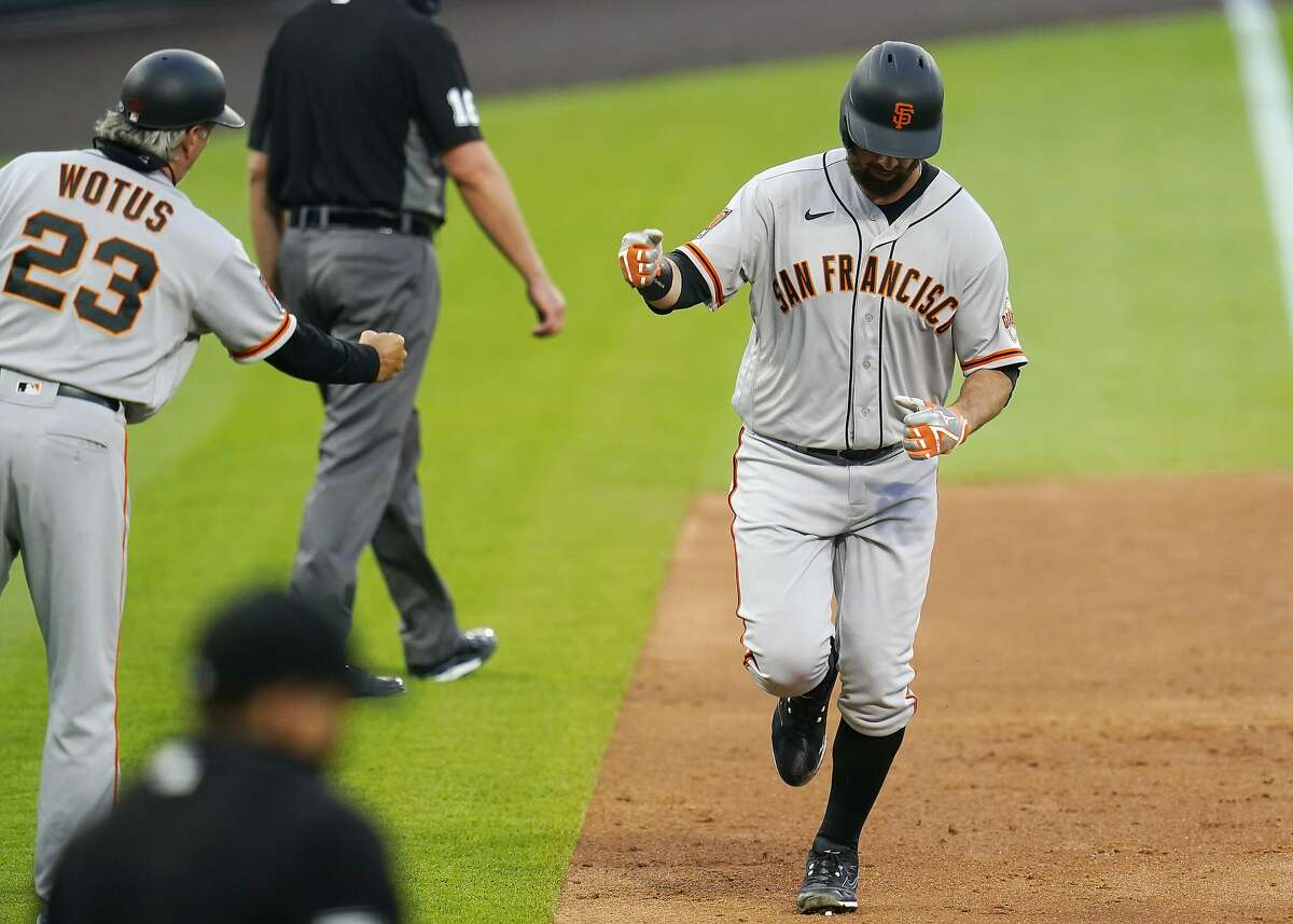 San Francisco Giants' Brandon Belt rounds the bases after hitting a three run home run against the Colorado Rockies during the fourth inning of a baseball game, Wednesday, Aug. 5, 2020, in Denver. (AP Photo/Jack Dempsey)