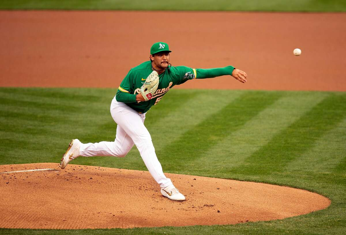 Oakland Athletics starting pitcher Sean Manaea (55) delivers a pitch against the Texas Rangers during the first inning of a Major League Baseball game on Wednesday, Aug. 5, 2020 in Oakland, Calif.