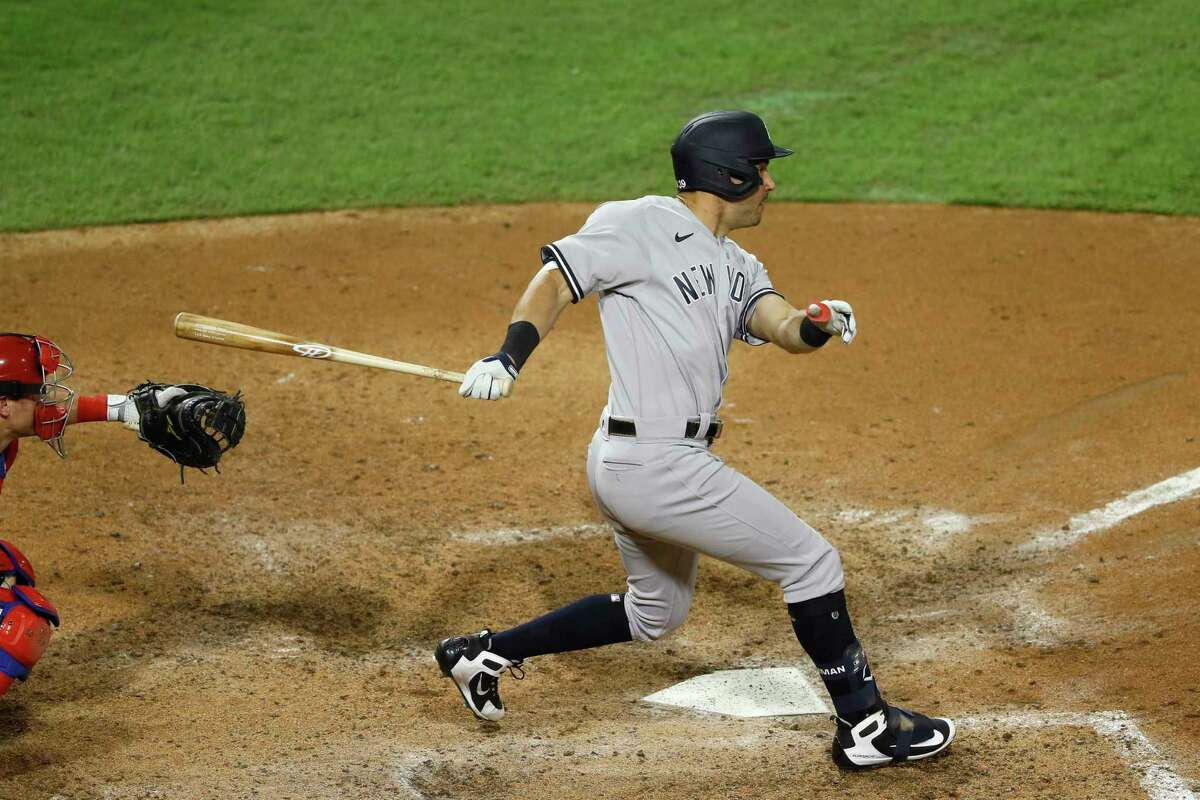New York Yankees' Mike Tauchman follows through after hitting an RBI double off Philadelphia Phillies relief pitcher Tommy Hunter during the seventh inning of the second baseball game in a doubleheader, Wednesday, Aug. 5, 2020, in Philadelphia. New York won 3-1. (AP Photo/Matt Slocum)