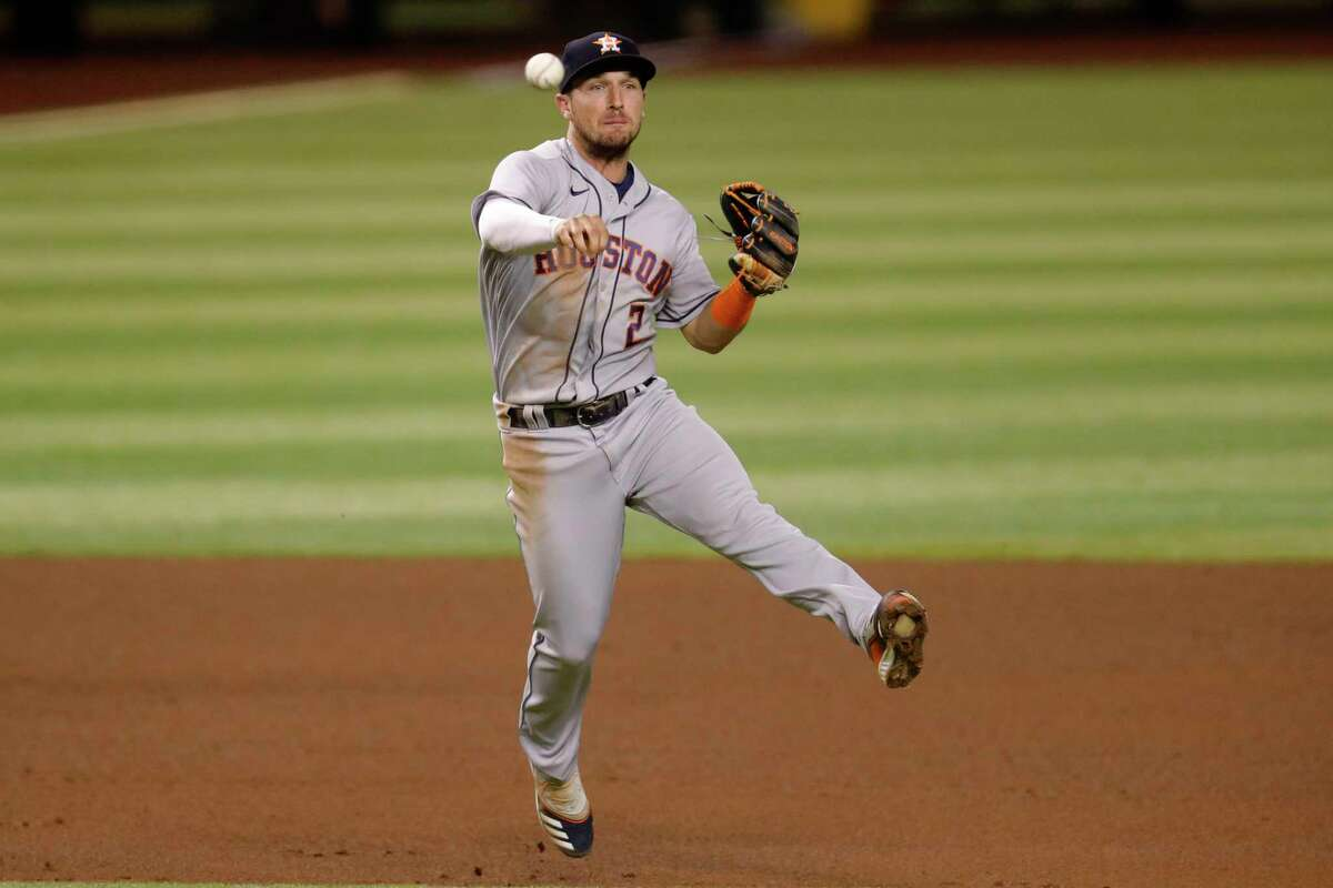 Houston Astros' Alex Bregman (2) throws out Arizona Diamondbacks' Nick Ahmed during the seventh inning of a baseball game Wednesday, Aug. 5, 2020, in Phoenix. (AP Photo/Matt York)