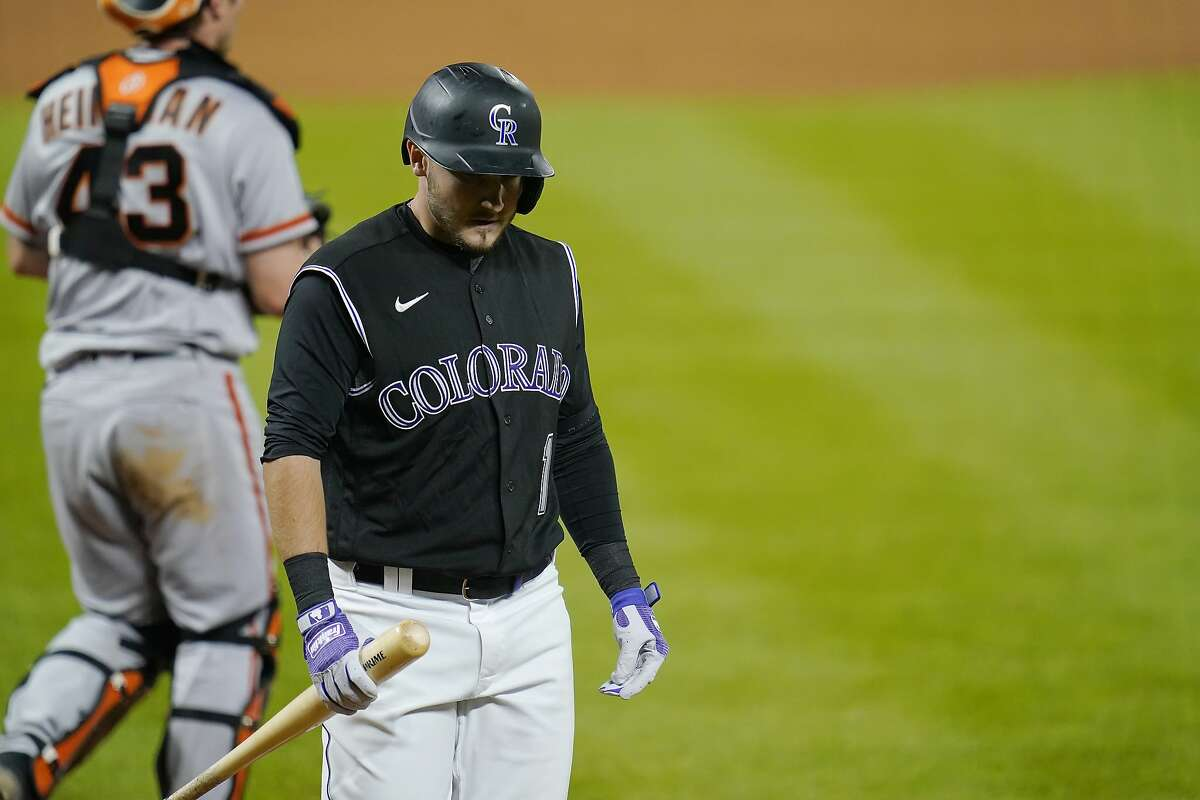 Colorado Rockies' Garrett Hampson reacts to striking out to end the game against the San Francisco Giants during a baseball game, Wednesday, Aug. 5, 2020, in Denver. The Giants beat the Rockies 4-3. (AP Photo/Jack Dempsey)