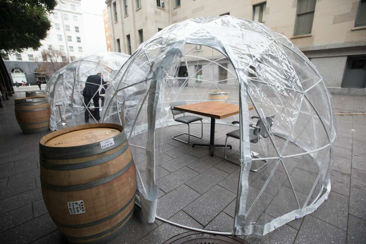 A look inside one of the dining structures. Sushi Hashiri opened up outdoor dining service using patio bubbles in front of their restaurant in Mint Plaza in San Francisco, California on Aug. 5, 2020.