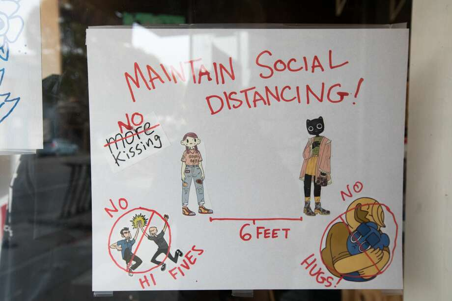 A sign at Silver Sprocket comics reminds customers to socially distance. The comic book store is taking over the space vacated by 1-2-3-4 Go! Records on Valencia Street in San Francisco, California on Aug. 5, 2020. Photo: Douglas Zimmerman/SFGATE / SFGATE