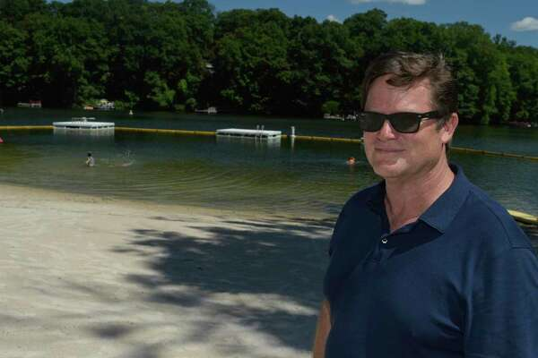 First Selectman Don Lowe stands on the Sherman Town Beach, on Candlewood Lake, Sherman, Conn. Monday, August 3, 2020.