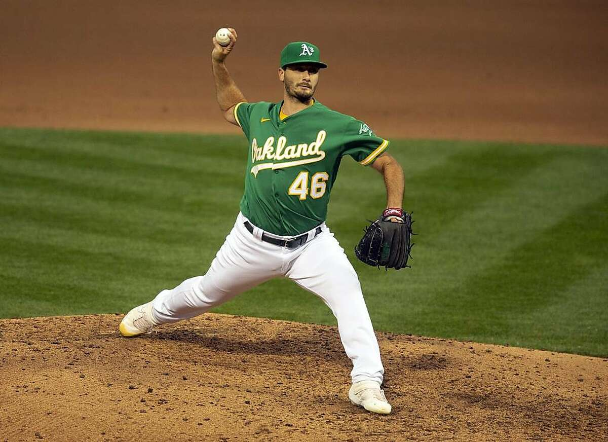 Oakland Athletics pitcher Burch Smith (46) delivers during the fourth inning of a Major League Baseball game on Wednesday, Aug. 5, 2020 in Oakland, Calif.