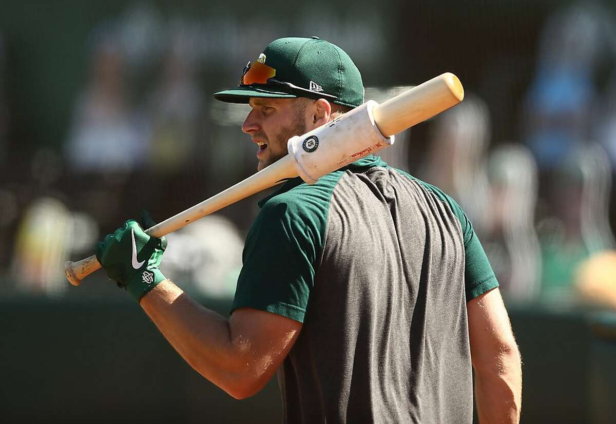 OAKLAND, CALIFORNIA - JULY 17: Seth Brown #15 of the Oakland Athletics takes batting practice during summer workouts at RingCentral Coliseum on July 17, 2020 in Oakland, California. (Photo by Ezra Shaw/Getty Images)