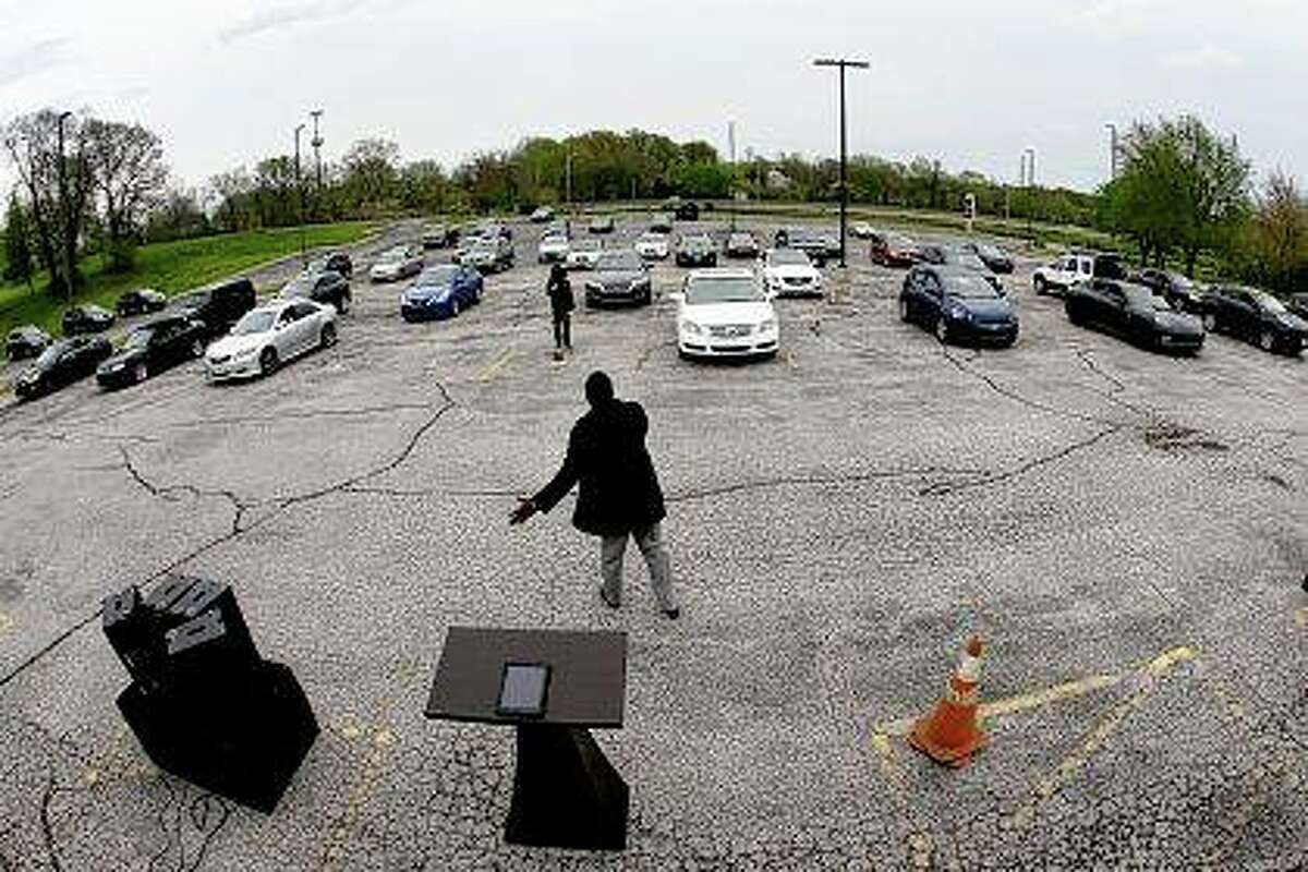 Pastor W.R. Starr II preaches April 12 during a drive-in Easter Sunday service as churchgoers listen from their cars in the parking lot at Faith City Christian Center in Kansas City, Kansas. The principle of religious freedom is important to most Americans. But as President Donald Trump touts his support for it during his reelection bid, there are notable fault lines among people of different faiths and political ideologies over what it truly means.