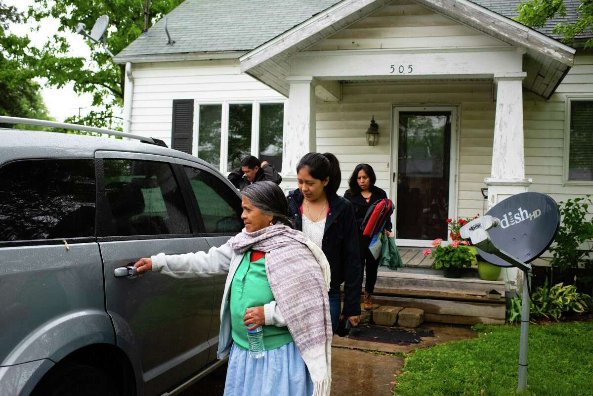 María Dominga Romero León, 68, opens the door to her family's car in Germantown, Ill., as they leave for a birthday party in nearby St. Louis. Others, from left to right, are Abdias Guardian, 39, Chelsy Guardian, 18, and Guillermina Sánchez, 38.