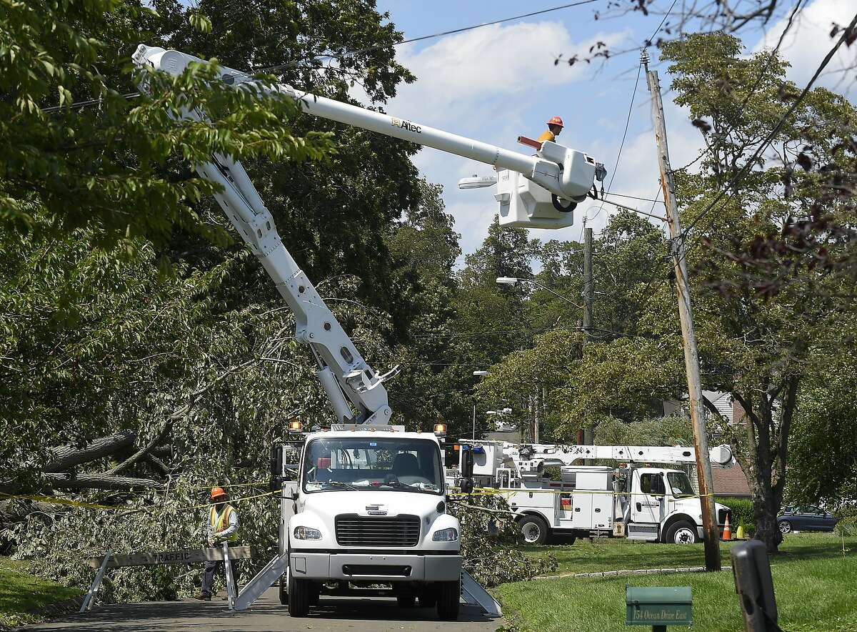 A utility crew from Asplundh Construction work to restore power in the Shippan neighborhood on August 5, 2020 in Stamford, Connecticut. Just 24 hours has passed since Tropical Storm Isaias pass through the region bringing heavy surf and damaging winds that has left over 9,000 Eversource customers in Stamford without power.