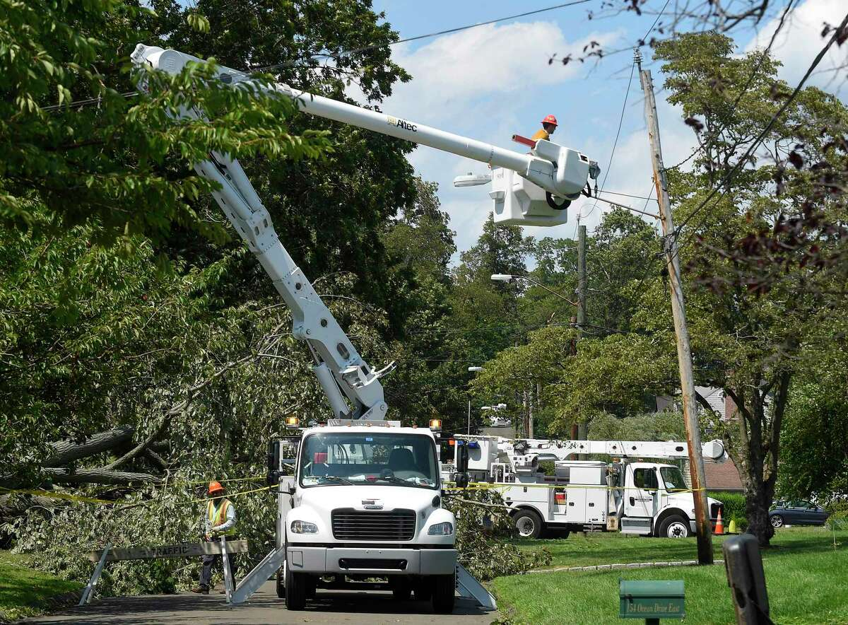 A utility crew from Asplundh Construction work to restore power in the Shippan neighborhood of Stamford on Wednesday. Damaging winds left over 9,000 Eversource customers there without power.