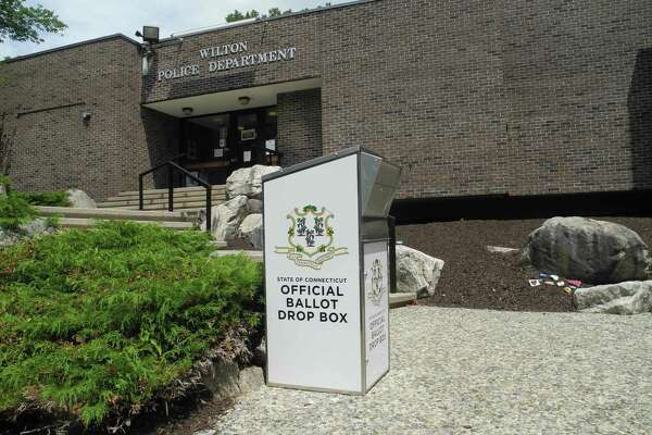 Voters who fill out absentee ballots may mail them in or drop them in this secure ballot box in front of police headquarters on the Wilton town hall campus on Danbury Road.