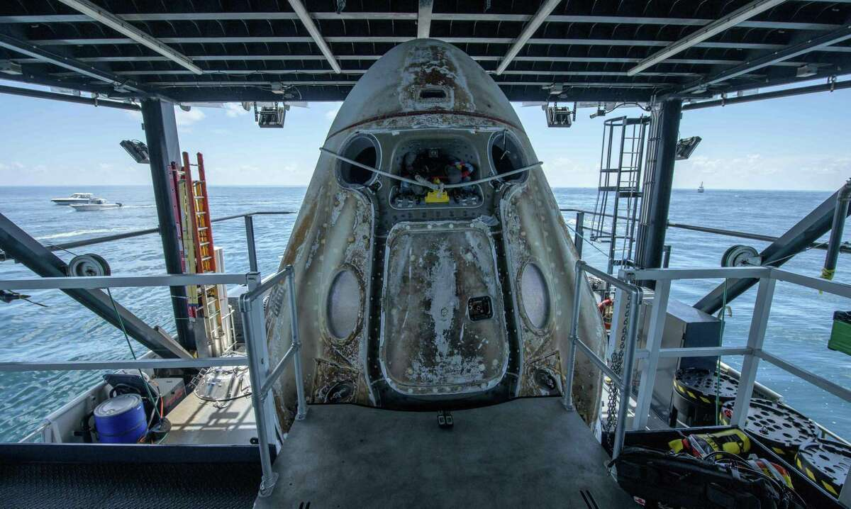 The SpaceX Crew Dragon Endeavour spacecraft, with NASA astronauts Bob Behnken and Doug Hurley onboard, is positioned on the SpaceX GO Navigator recovery ship shortly after landing in the Gulf of Mexico off the coast of Pensacola, Fla., on Aug. 2, 2020.