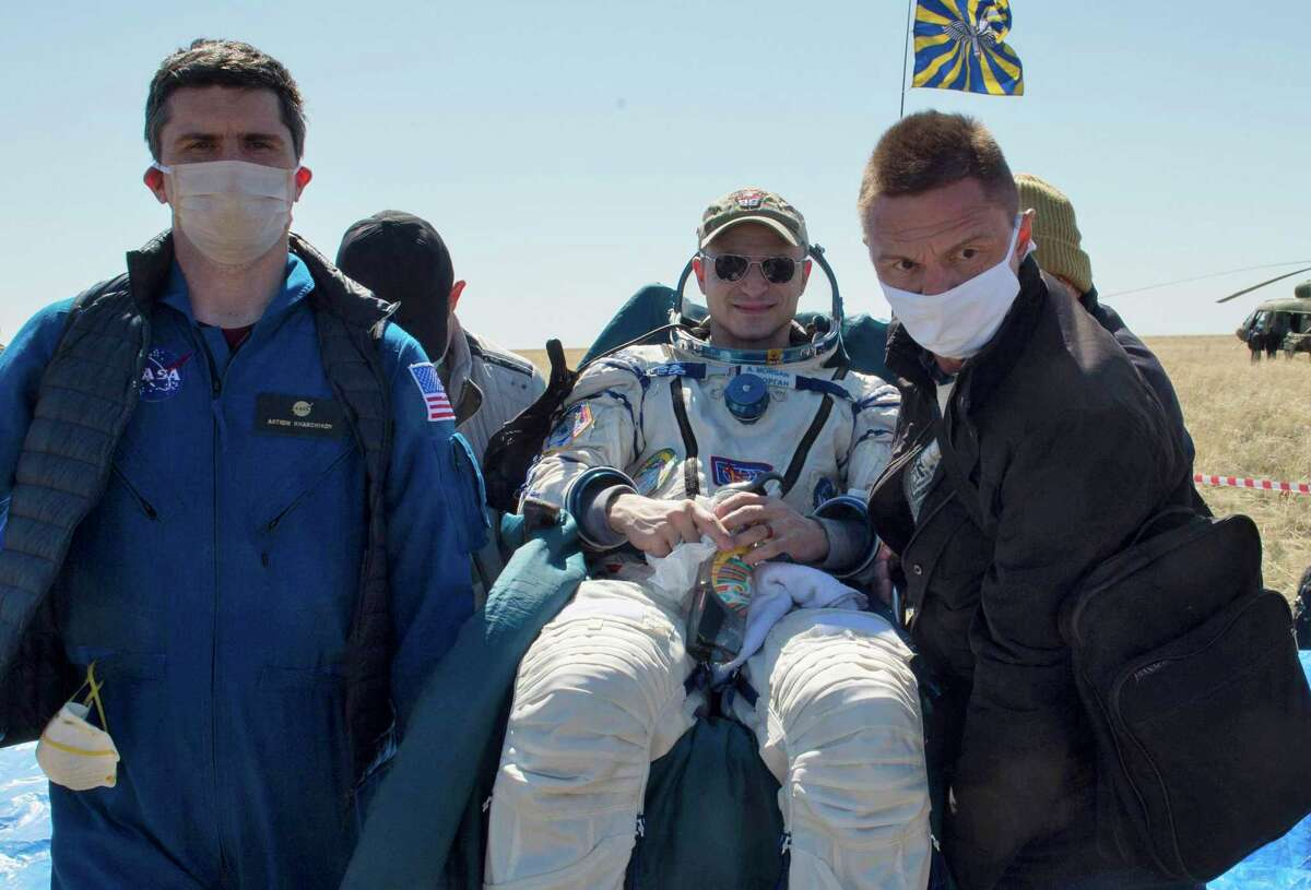In this handout photo released by Gagarin Cosmonaut Training Centre, Roscosmos space agency, rescue team members carry U.S. astronaut Andrew Morgan shortly after the landing of the Russian Soyuz MS-15 space capsule near Kazakh town of Dzhezkazgan, Kazakhstan, Friday, April 17, 2020.