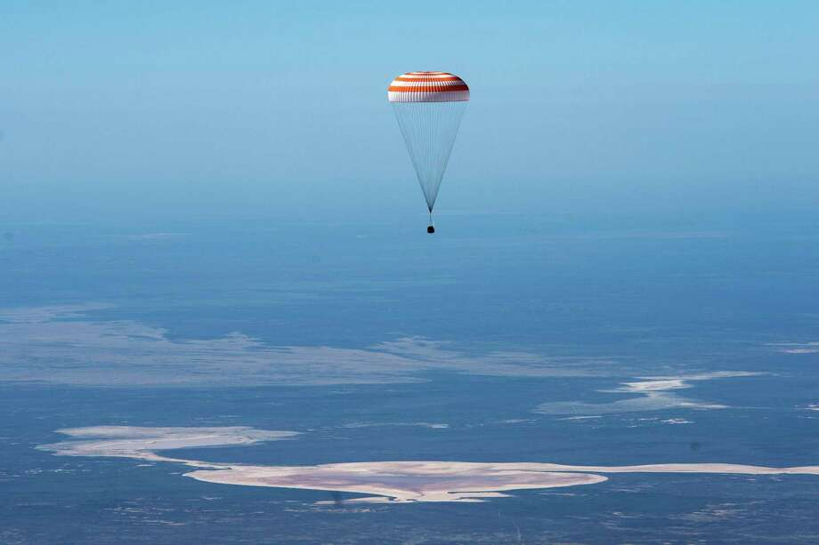 In this handout photo released by Gagarin Cosmonaut Training Centre, Roscosmos space agency, the Soyuz MS-15 space capsule carrying International Space Station (ISS) crew members descends beneath a parachute just before landing in a remote area near Kazakh town of Dzhezkazgan, Kazakhstan, Friday, April 17, 2020. Photo: Andrey Shelepin, HOGP / Associated Press / Gagarin Cosmonaut Training Centre (GCTC), Roscosmos space agency