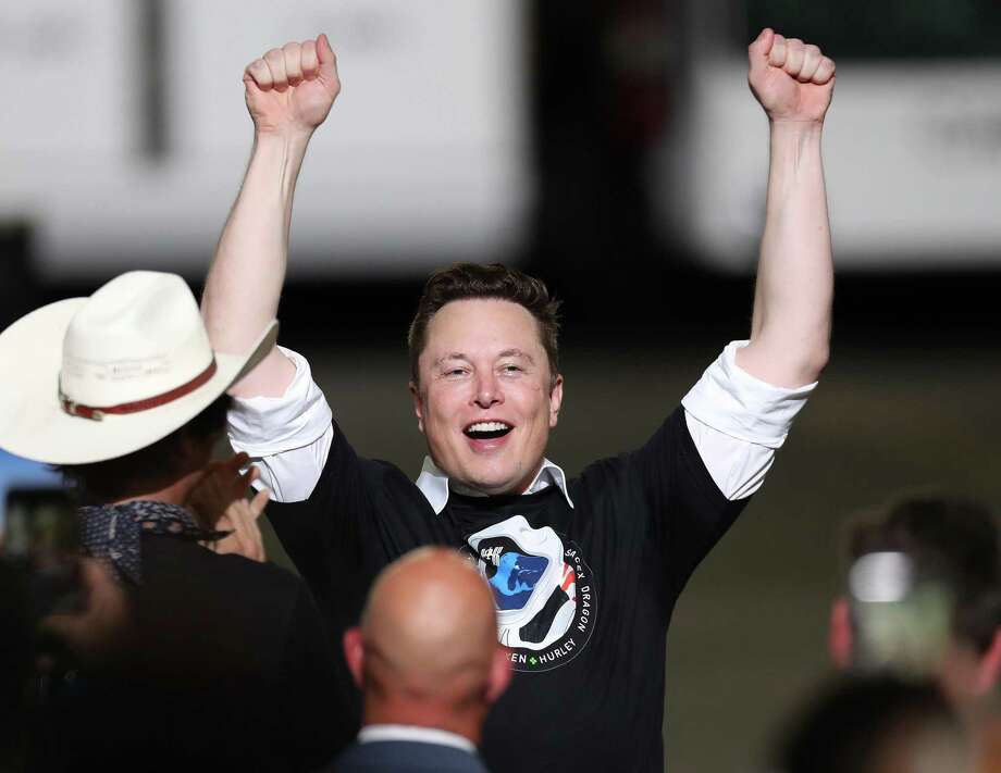 SpaceX founder Elon Musk celebrates after the successful launch of the SpaceX Falcon 9 rocket with the Crew Dragon spacecraft at the Kennedy Space Center on May 30, 2020 in Cape Canaveral, Fla. Photo: Joe Raedle, Staff / Getty Images / 2020 Getty Images