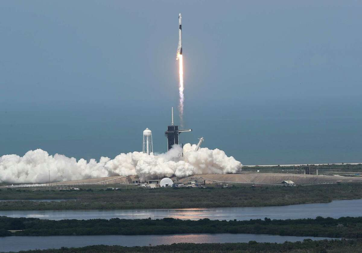 The SpaceX Falcon 9 rocket with the Crew Dragon spacecraft attached takes off from launch pad 39A at the Kennedy Space Center on May 30, 2020 in Cape Canaveral, Florida. NASA astronauts Bob Behnken and Doug Hurley lifted off today on an inaugural flight and will be the first people since the end of the Space Shuttle program in 2011 to be launched into space from the United States.