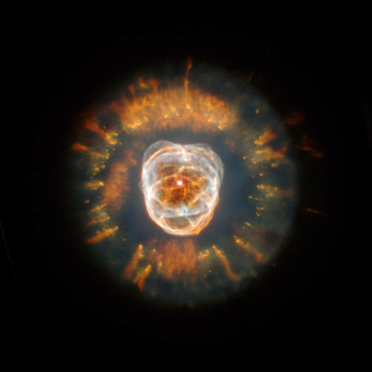 Pictured is planetary nebula NGC 2392, the glowing remains of a Sun-like star that is blowing off its outer layers at the end of its life.