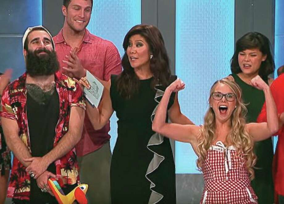 Ubly's Nicole Franzel (right) pumps her fists in the air after host Julie Chen (center) announces that Nicole made Big Brother history by becoming the first woman to beat a man, Paul Abrahamian (far left), in the finals. Nicole outlasted 15 other houseguests and on Sept. 21 was crowned this season's Big Brother champion. (CBS photo)