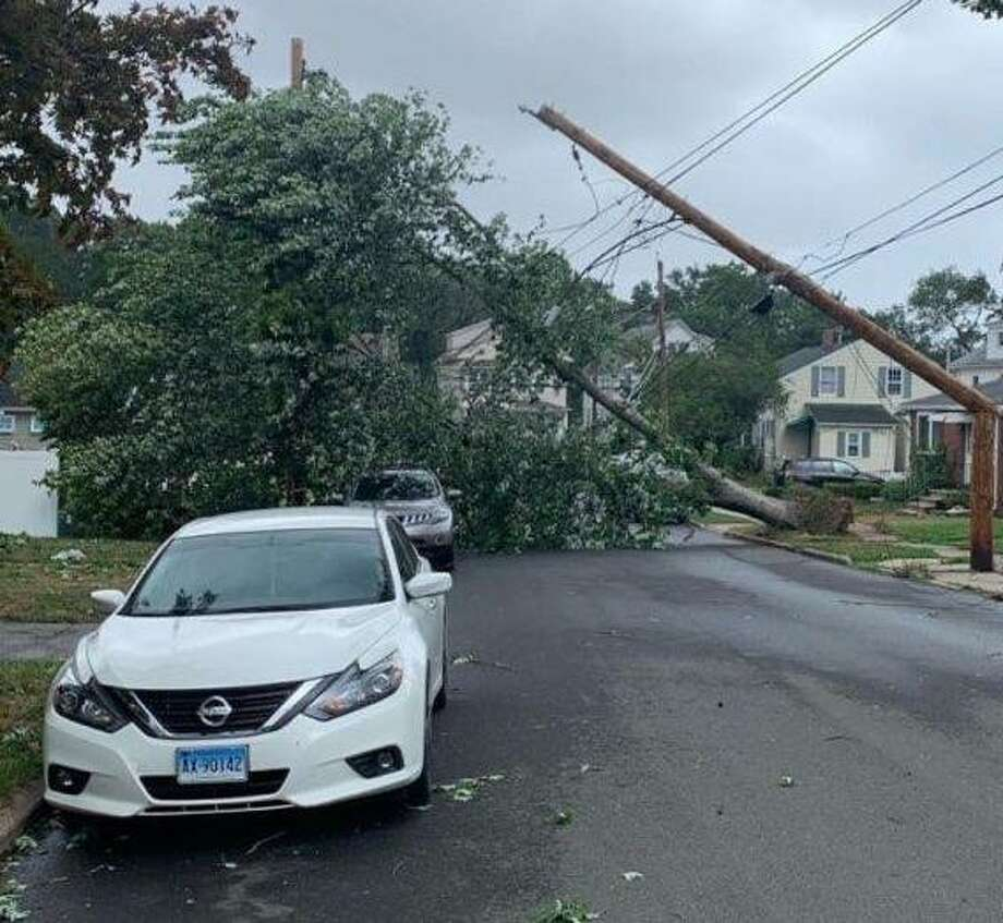 A fallen tree brought down  power lines and damaged a transformer on Dwight Place in East Haven, cutting power to residents of the five-unit Cornerstone Walk condominium complex. As of Thursday morning, they were still without power. Photo: Elaine Charpentier / Contributed Photo