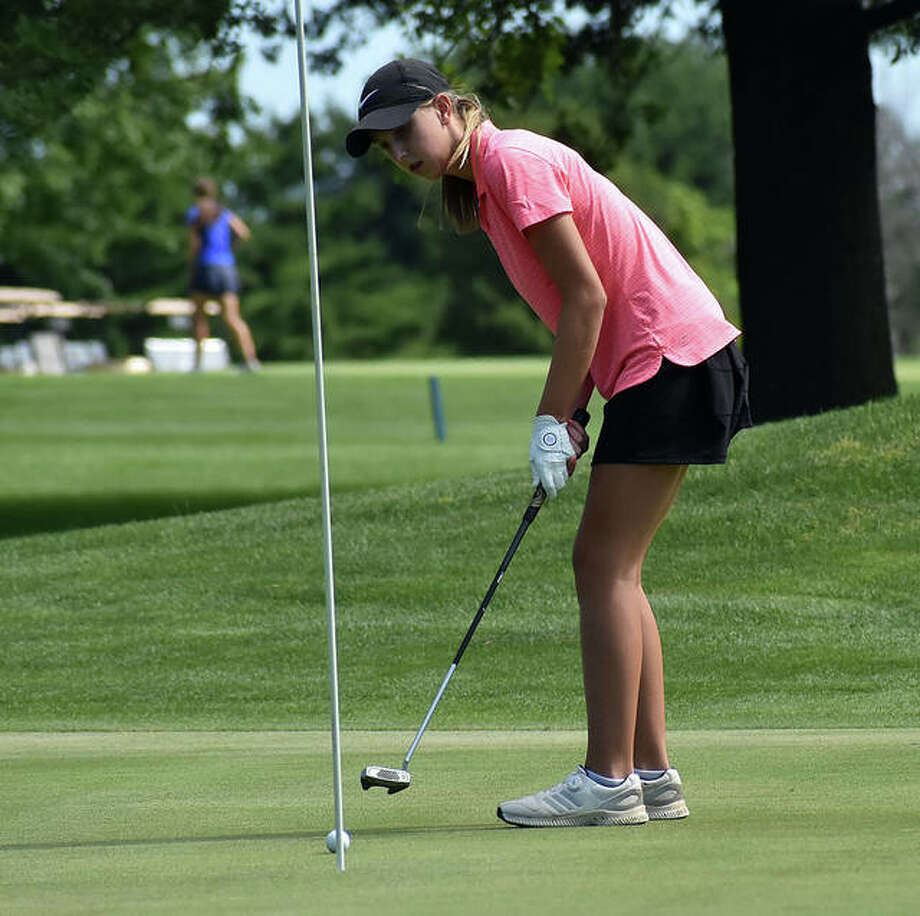 Edwardsville's Grace Daech watches as her putt rolls towards the hole on No. 7 at Hickory Point Golf Course on Tuesday in Forsyth. Photo: Matt Kamp|The Intelligencer