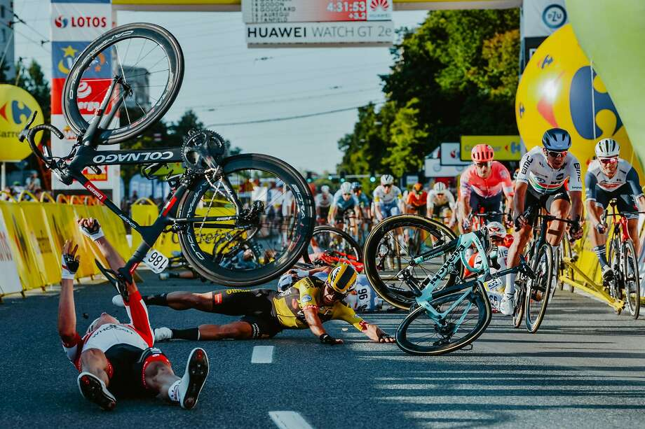 Dutch cyclist Dylan Groenewegen (on the ground ,center) and fellow riders collide during the opening stage of the Tour of Poland race in Katowice , southern Poland on August 5, 2020. - Dutch rider Fabio Jakobsen was fighting for his life on Wednesday after he was thrown into and over a barrier at 50 miles an hour in a sickening conclusion to the opening stage of the Tour of Poland. Photo: Szymon Gruchalski, Forum/AFP Via Getty Images