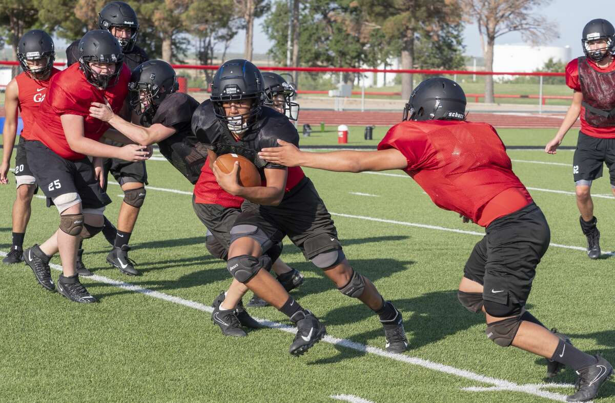 Garden City football players run drills 8/06/2020. Tim Fischer/Reporter-Telegram