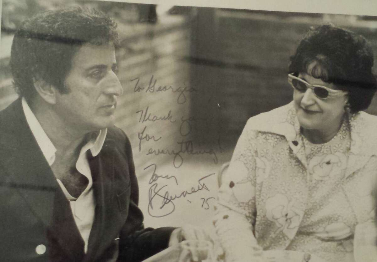 Jazz writer Georgia Urban, right, with Tony Bennett, in a 1975 photo signed for her by the singer.