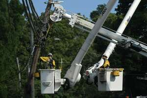 Eversource repairs damage to utility lines following damage wrought by tropical storm Isaias Wednesday, August 5, 2020, which brought down trees with wind gusts up to 70 miles per hour in Norwalk, Conn.