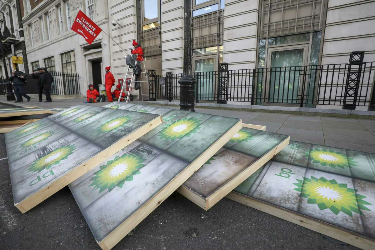 Placards lie on the ground during a protest by Greenpeace activists outside BP headquarters in London. Like other oil companies, BP has come under fire for its contribution to climate change.