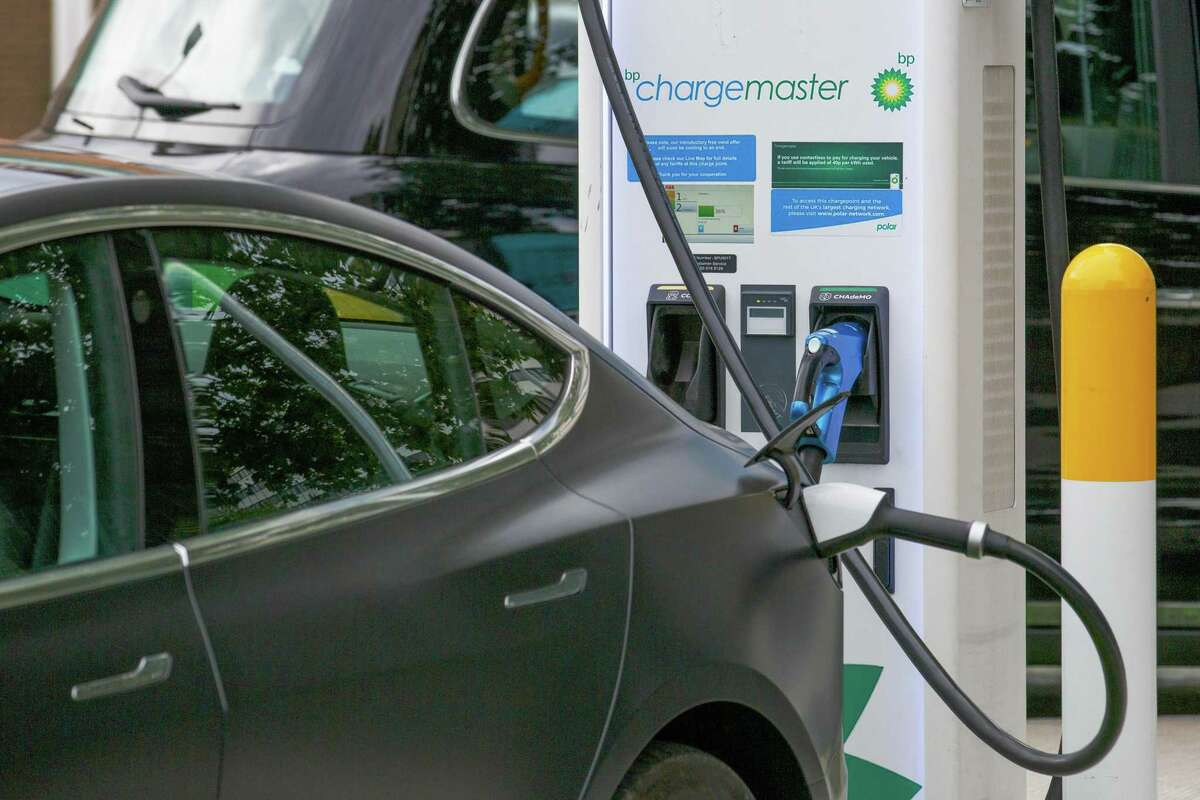 An electronic automobile, manufactured by Tesla Inc. charges at a BP Plc petrol and refueling station in London, U.K., on Tuesday, Aug. 4, 2020. BP Plc cut its dividend for the first time in a decade, removing a cornerstone of its investment case after the coronavirus pandemic upended almost every aspect of its business.