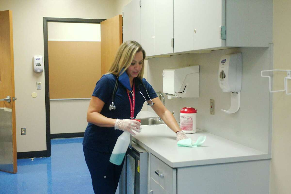 """Bondy Intermediate School nurse Ashley Pressly prepares the Pasadena ISD school's clinic for the return of students. """"I really care about kids' emotional and mental health,"""" Pressly says. """"Fear doesn't serve us well in regards to our health."""""""