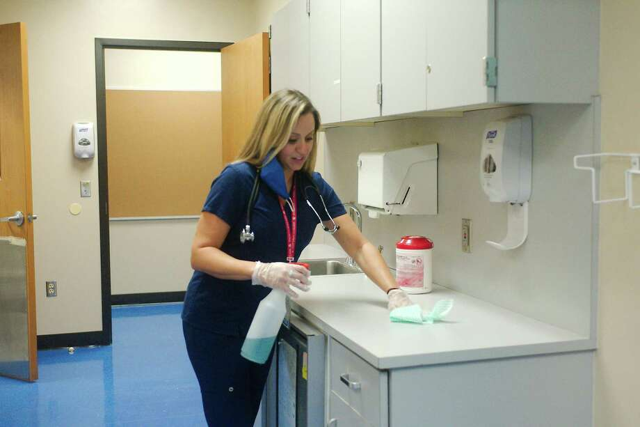 "Bondy Intermediate School nurse Ashley Pressly prepares the Pasadena ISD school's clinic for the return of students. ""I really care about kids' emotional and mental health,"" Pressly says. ""Fear doesn't serve us well in regards to our health."" Photo: Kirk Sides / Staff Photographer / © 2020 Houston Chronicle/Kirk Sides"