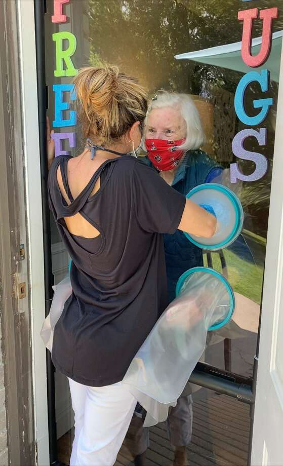 Houston-area couple, Steve and Amber Crenshaw, created a pandemic-safe and has proven to be cool new way for seniors in one Woodlands assisted living community to connect to their loved ones. Photo: Amber Crenshaw