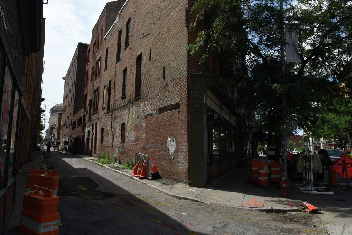 View looking down Franklin Alley on Thursday, Aug. 6, 2020, in Troy, N.Y. Through a partnership with property owners, businesses and non-profits including the Arts Center of the Capital Region, the one-block section between River Street and Broadway is to undergo a major makeover, with the installation of overhead lighting, murals and eventually programming and cafŽ seating. (Will Waldron/Times Union)