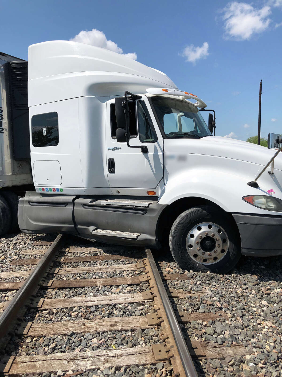 23 immigrants were discovered inside the trailer of a truck that was stuck on railroad tracks near mile marker 14 of I-35.