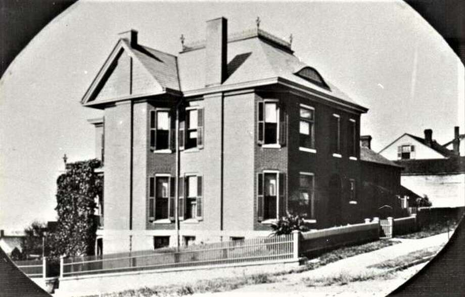 The historic Koenig House, built in 1897 by Julius Koenig and designed by noted Alton architect Lucas Pfeiffenberger, as it appeared before brick streets were installed throughout the city. Photo: Courtesy Of The Alton Area Landmarks Association |The Telegraph