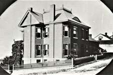 The historic Koenig House, built in 1897 by Julius Koenig and designed by noted Alton architect Lucas Pfeiffenberger, as it appeared before brick streets were installed throughout the city.