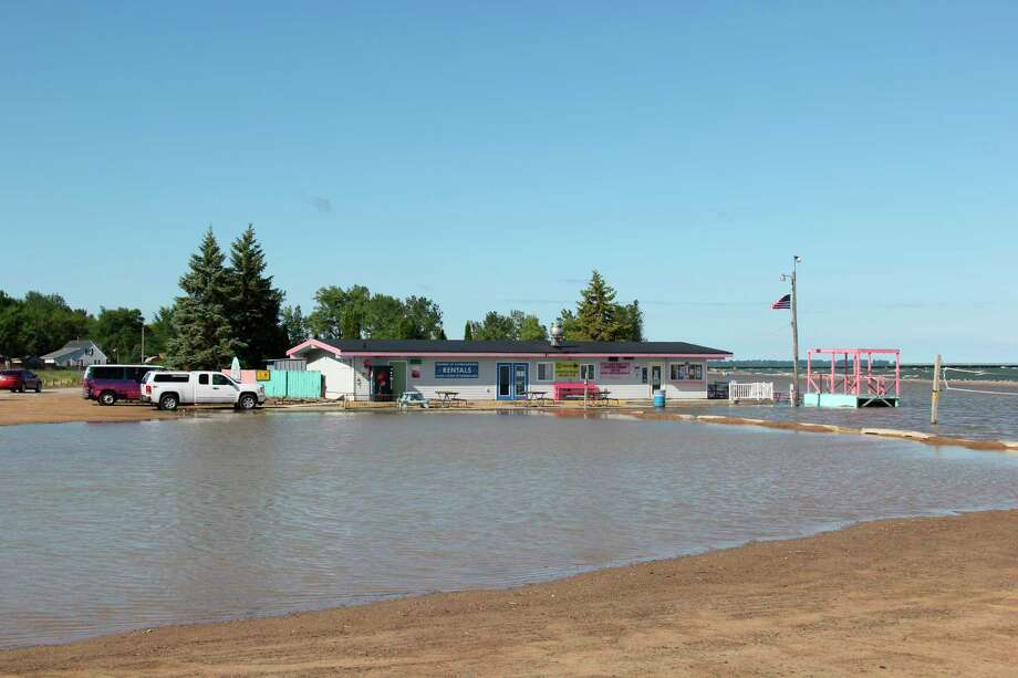 The Baywatch on the Beach Grill at the Caseville County Park beach was surrounded by water on Wednesday morning. The Huron County Road Commission dug out trenches to alleviate the flooding on Wednesday afternoon. (Robert Creenan/Huron Daily Tribune)